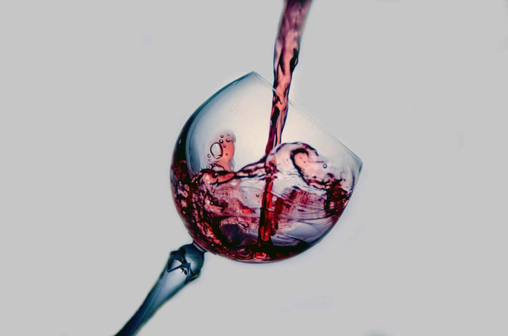 Alcohol during lockdown - wine being poured